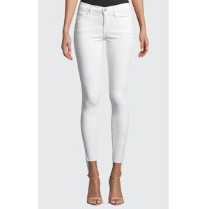 FRAME Le Jeanne Mid-Rise Skinny Jeans in White.